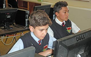 Middle School students work on a creative writing assignment in a computer lab.