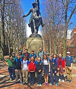 At the Paul Revere statue in Boston during the Middle School's annual study abroad trip.
