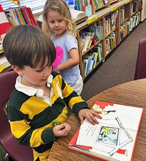 "Preschooler reads ""Green Eggs and Ham"" by Dr. Seuss"