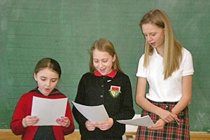 Students in a multi-age reading class perform a ballad.