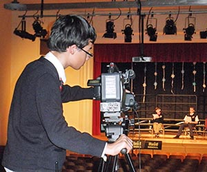 Setting up a camera for school-wide news cast.