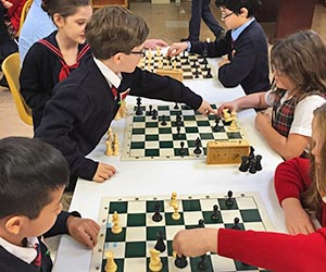 Chess Club members compete in a tournament.