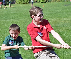 Students tug-a-rope during the Mini-mini Olympics.