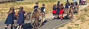 Students learn of pioneer migration to Utah while pulling handcarts at This Is The Place Heritage Park.