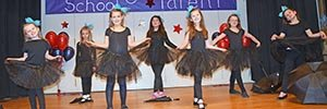 Elementary School girls perform a dance for the annual Talent Show.